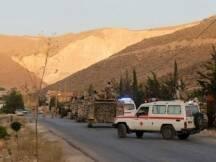 يستكمل الدفاع المدني انتشال جثث الارهابيين التكفيريين الذين سقطوا